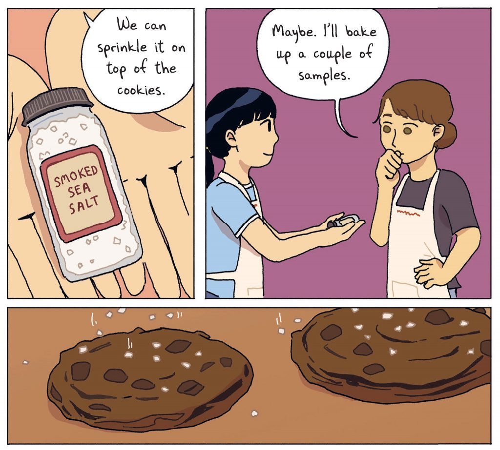 """Three panels from the book: Panel 1 shows a container of smoked sea salt and a character saying, """"We can sprinkle it on top of the cookies."""" Panel 2 shows another character saying, """"Maybe. I'll bake up a couple of samples."""" Panel 3 shows a close-up of the cookies with sea salt being added on top."""